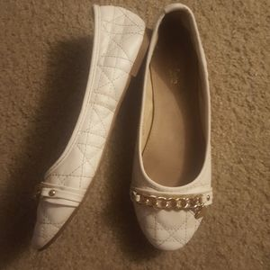 White flats with embellishment